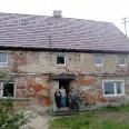 Dom rodziny Janickich po remoncie z wymienionym dachem i oknami